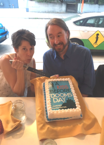 Kristin Nelson and Laurence MacNaughton cut the cake at Tattered Cover